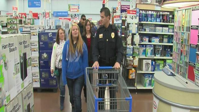 Green Country children and cops go shopping for Christmas presents in Bixby