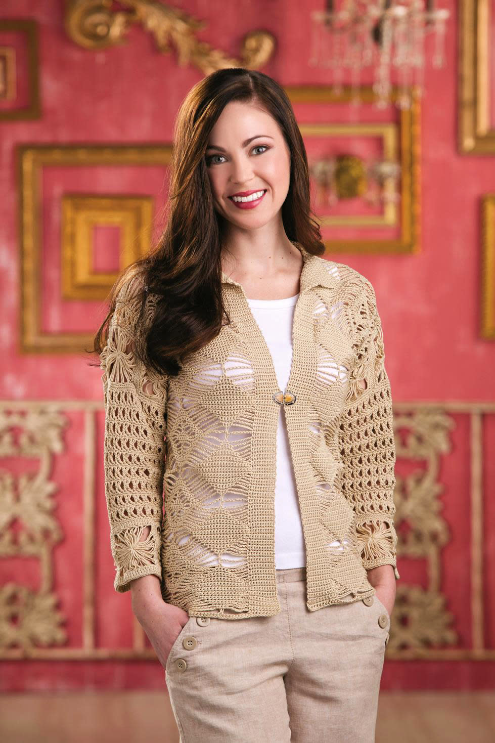 """This publicity photo provided by """"Crochet!"""" magazine (Summer 2013) published by Annie's shows the openwork pattern of the Macrame Cardi, inspired by the retro craft but retooled for modern tastes. Today's crochet is leaner and trendier than that of the 1960s and '70s, from which we know it for its bulky, acrylic yarns and Afghan blankets. (AP Photo/Crochet!, Matthew Owen)"""