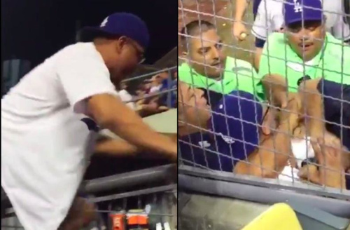 A fan is subdued and arrested immediately after jumping in the Astros bullpen during World Series Game 2. (Robert Littal on Twitter)