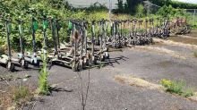 At least 57 e-scooters and bikes found at the bottom of Portland river
