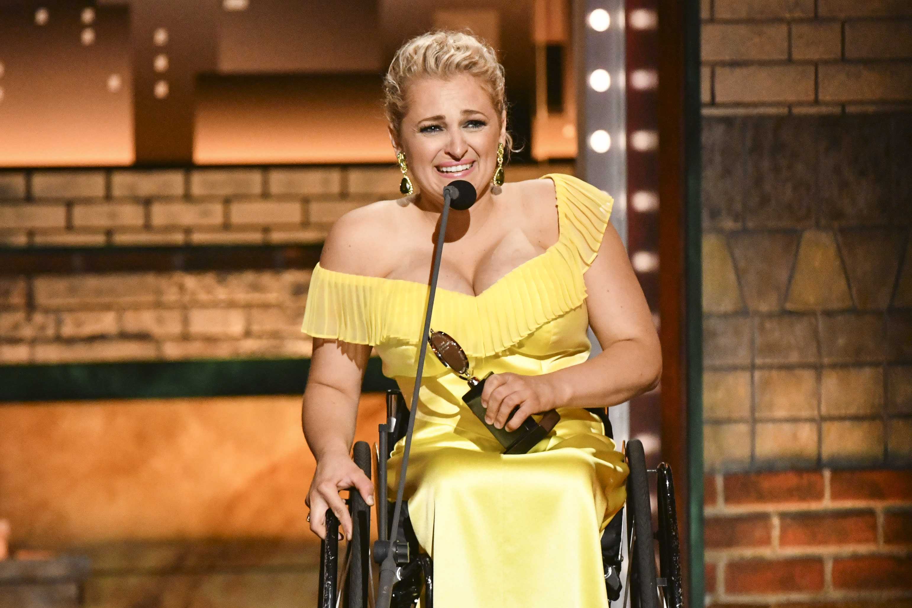 "Ali Stroker accepts the award for best performance by an actress in a featured role in a musical for ""Rodgers & Hammerstein's Oklahoma!""at the 73rd annual Tony Awards at Radio City Music Hall on Sunday, June 9, 2019, in New York. (Photo by Charles Sykes/Invision/AP)"