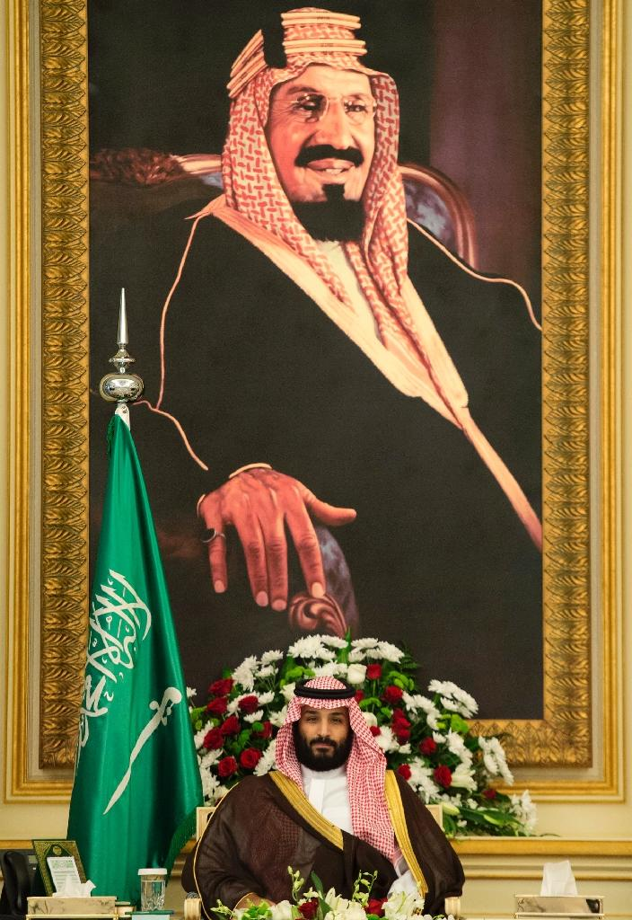 Saudi Crown Prince Mohammed bin Salman attends a meeting in Jeddah, under a portrait of King Abdulaziz al-Saud, the founder of the Saudi kingdom (AFP Photo/BANDAR AL-JALOUD)