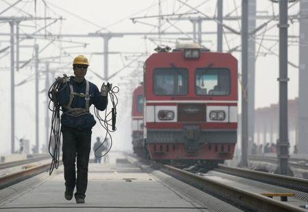 A worker walks at the construction site of the Beijing-Tianjin high-speed passenger rail line in Tianjin municipality