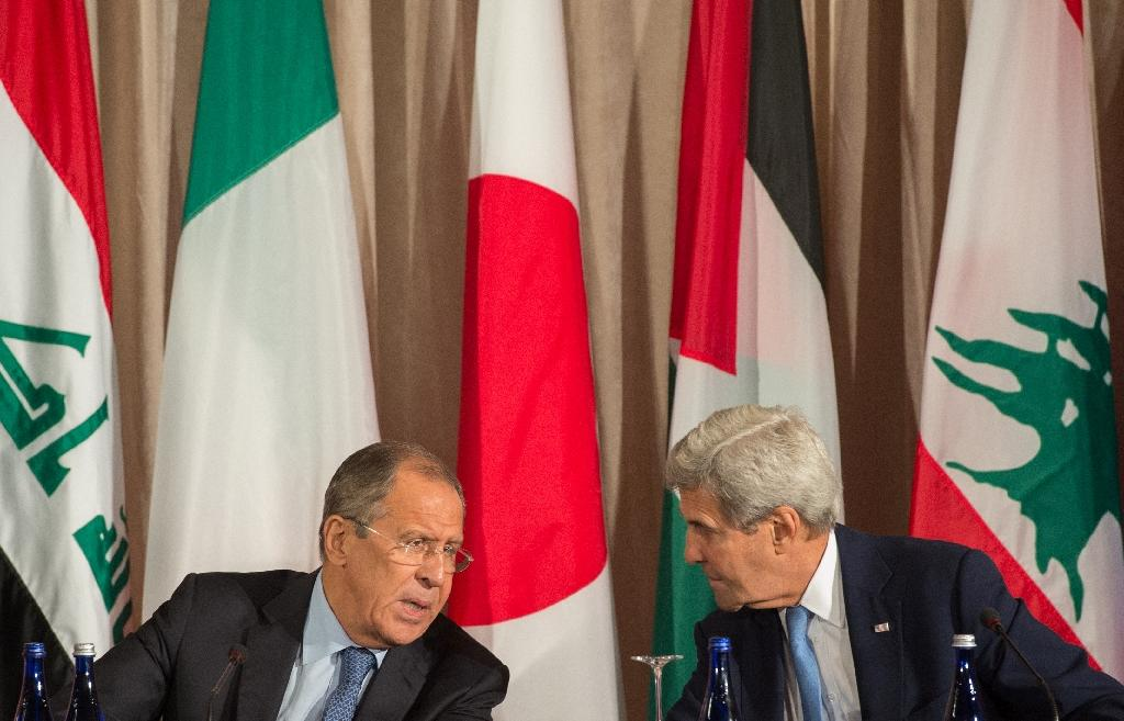 Russian Foreign Minister Sergei Lavrov and United States Secretary of State John Kerry speak during the International Syria Support Group meeting, September 22, 2016 in New York