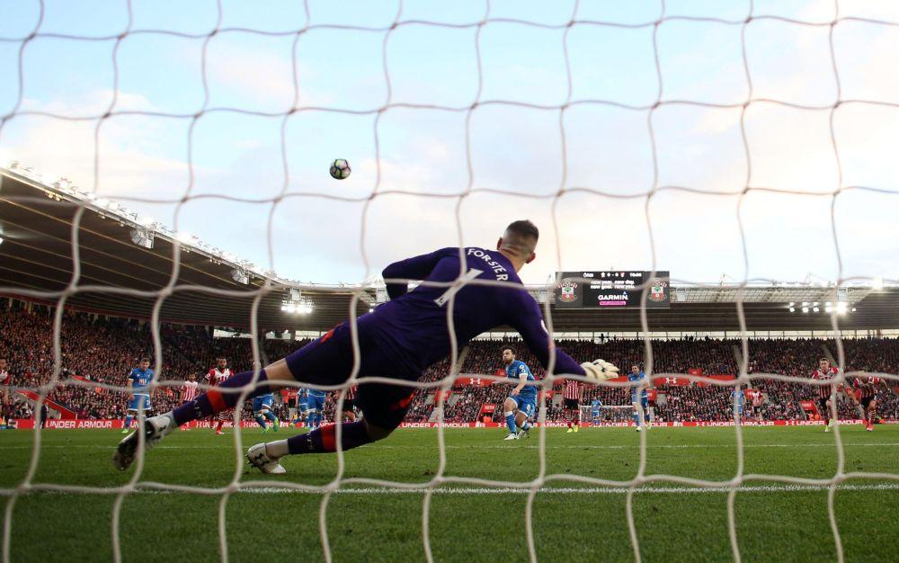 Harry Arter blazes the ball over - Rex Features