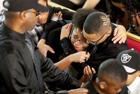 A mourner cries at the funeral for Corey Jones at the Payne Chapel AME of West Palm Beach