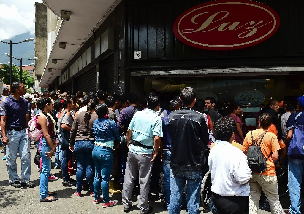 Venezuela has faced months of political wrangling and street protests, played out against a backdrop of queues for basic food and household items (AFP Photo/Ronaldo Schemidt)