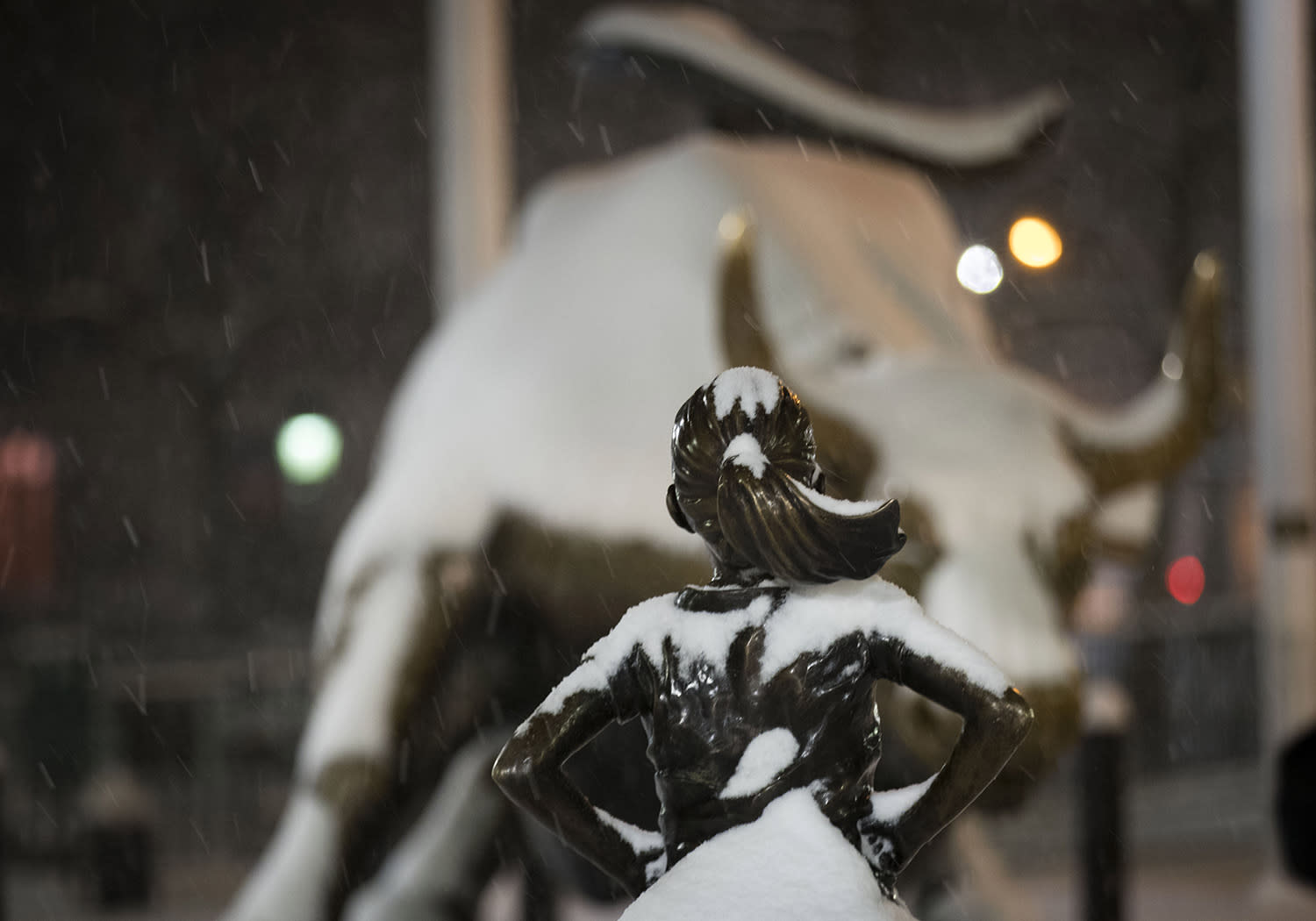 """<p>The """"Fearless Girl"""" statue stands in the snow in the early morning hours in the Financial District, March 14, 2017, in New York. (Drew Angerer/Getty Images) </p>"""
