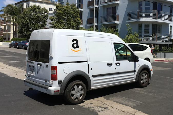 An Amazon.com Inc truck makes deliveries in Los Angeles, California, U.S., May 21, 2016. REUTERS/Lucy Nicholson