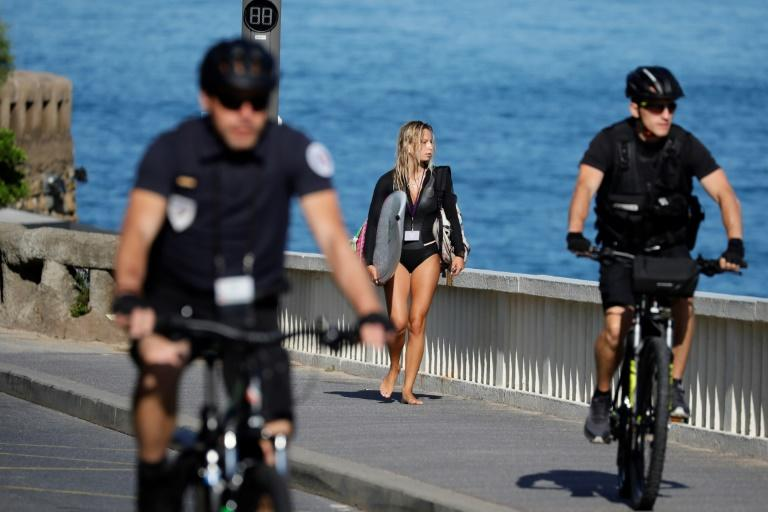 Surfers have been ordered out of the water on the central beach, the Grande Plage, while the train station and airport are set to close later Friday for the weekend. (AFP Photo/Thomas SAMSON)