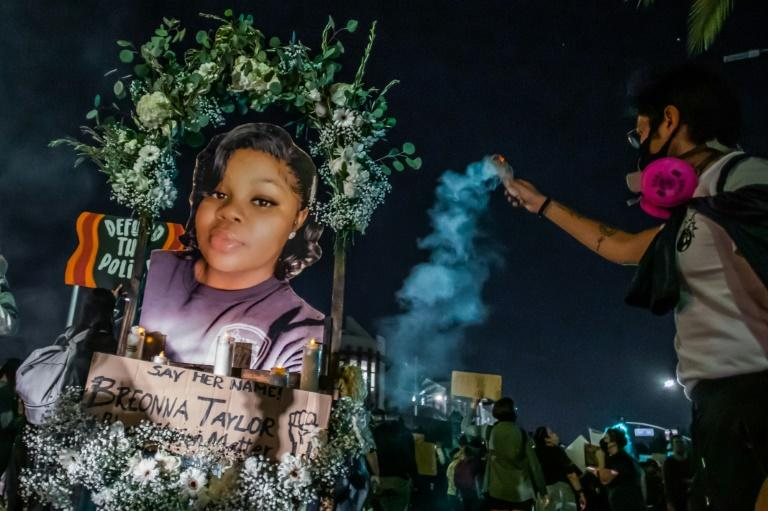 Protesters hold up a picture of Breonna Taylor as they march against police brutality in Los Angeles, on September 23, 2020