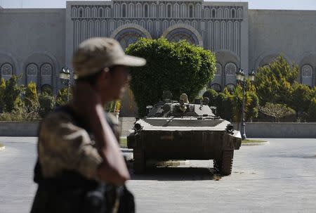 A Houthi militiaman looks on as he stands at the yard of the Republican Palace in Sanaa February 25, 2015. REUTERS/Khaled Abdullah