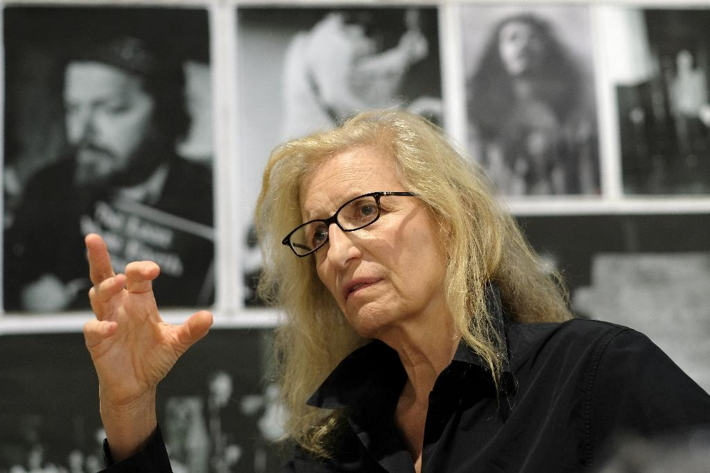 """US photographer Annie Leibovitz poses during her exhibition entitled """"Annie Leibovitz Archive Project #1: The Early Years"""" on May 24, 2017 at the Zurich-based nonprofit LUMA Foundation outpost at the Parc des Ateliers in Arles, southern France"""