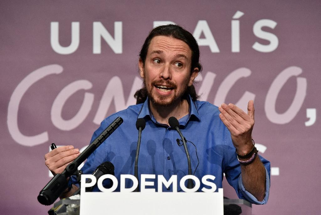 Leader of Spanish left wing party Podemos and general election candidate Pablo Iglesias speaks during a press conference about the results of Spain's general elections in Madrid on December 21, 2015 (AFP Photo/Gerard Julien)