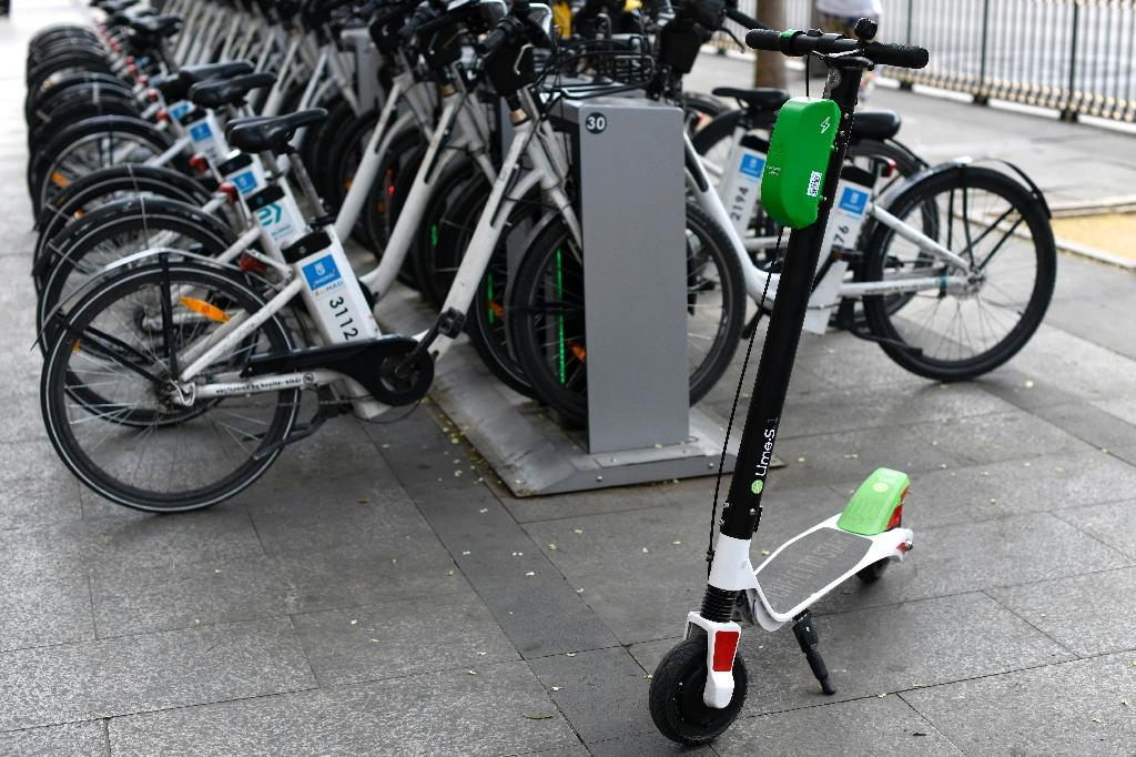 Lime scooters are tolerated by Madrid's left-wing city hall, intent on reducing pollution (AFP Photo/GABRIEL BOUYS)