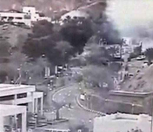 An image made from a video provided by the Israeli Airports Authority shows smoke, white area at upper right, from the bombing of the bus carrying South Korean sightseers near the tip of the Red Sea's Gulf of Aqaba Sunday, Feb. 16, 2014. At least three South Korean tourists were killed and 12 seriously wounded, according to Egyptian security officials. (AP Photo/Israeli Airports Authority)