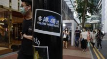'Liberate Hong Kong' slogan banned as protesters lay low