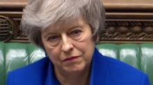 UK's 'zombie PM' May battles on alone
