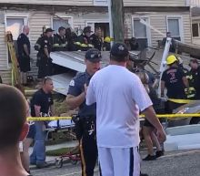 The Latest: At least 22 people injured in deck collapse