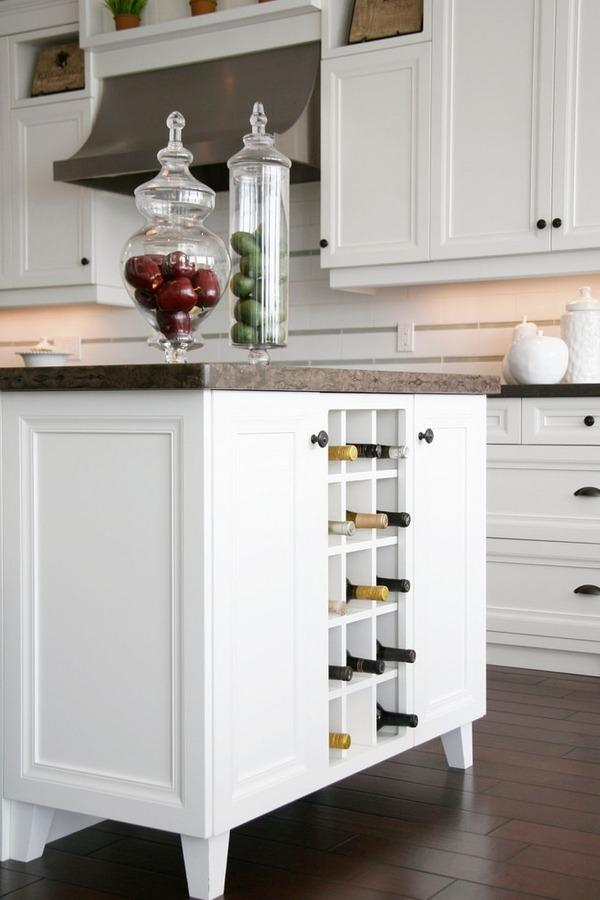 """<p>'Cause why not utilize every square inch of your kitchen island? Turn it into a DIY project by removing a cabinet and adding in small shelves. (Photo: <a href=""""http://www.minimalisti.com/architecture/interior-design/09/modern-wine-racks-ideas-wine-storage.html"""" rel=""""nofollow noopener"""" target=""""_blank"""" data-ylk=""""slk:Minimalisti"""" class=""""link rapid-noclick-resp"""">Minimalisti</a>)</p>"""