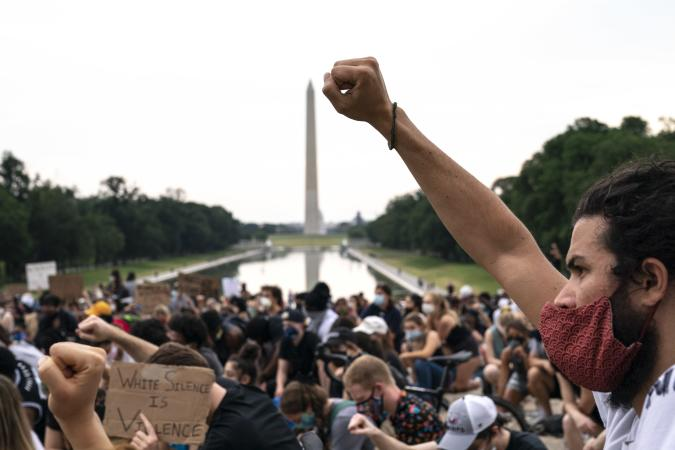WASHINGTON, DC - JUNE 04: Demonstrators take a knee as at the base of the Lincoln Memorial as they peacefully protest against police brutality and the death of George Floyd, on June 4, 2020 in Washington, DC. Protests in cities throughout the country have been largely peaceful following the death of George Floyd, a black man who was killed in police custody in Minneapolis on May 25. (Photo by Drew Angerer/Getty Images)
