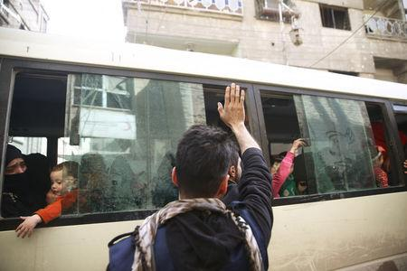 A man gestures as people are evacuated in the besieged town of Douma, Eastern Ghouta, in Damascus, Syria March 19, 2018. REUTERS/Bassam Khabieh