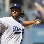 Kershaw wins 18th, Grandal powers Dodgers past Giants 3-1