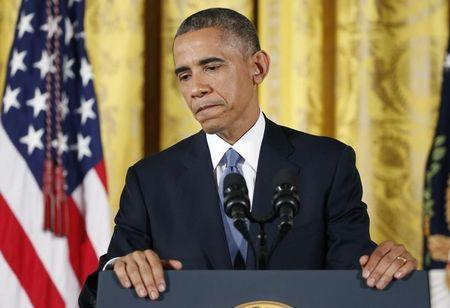 US President Obama answers questions at news conference at White House after mid term elections