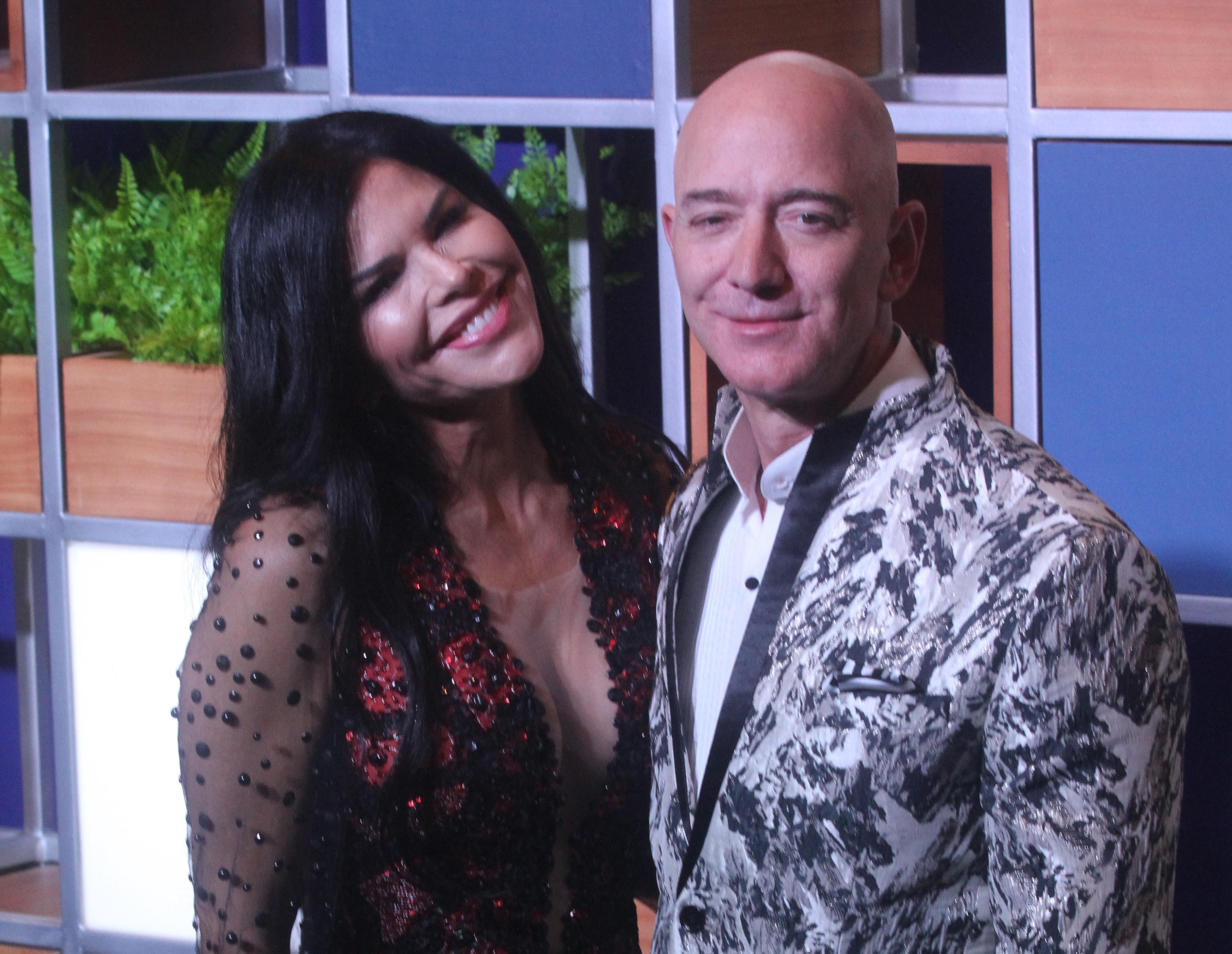 Jeff Bezos and Lauren Sanchez hold hands during red carpet debut in India