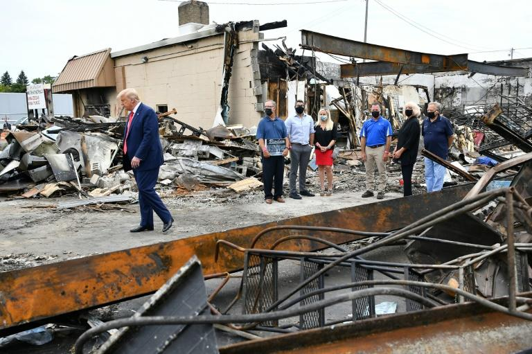 US President Donald Trump tours an area affected by civil unrest in Kenosha, Wisconsin on September 1, 2020