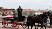 Photos show Congressman John Lewis crossing the infamous Edmund Pettus Bridge one last time