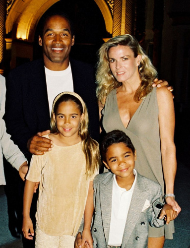 O.J. and Nicole Brown Simpson pose with their children, Sydney, left, and Justin, in 1994. (Photo: Berliner Studio/BEImages)