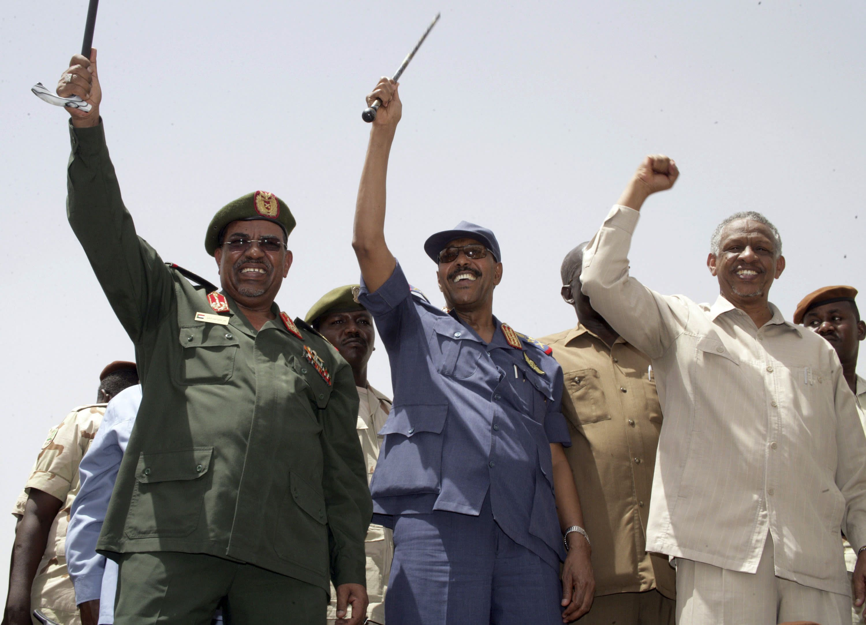 FILE - In this May 14, 2008 file photo, then Sudan's President Omar al-Bashir, Defense Minister Gen. Abdul-Rahim Mohammed Hussein, and Deputy Chairman of the National Congress Party Nafi Ali Nafi, from left to right, address a state-orchestrated rally in the capital Khartoum, Sudan. Activists are calling for mass protests in the capital, Khartoum, and elsewhere across the country to demand the disbanding of the National Congress Party. The Sudanese Professionals' Association, which spearheaded the uprising against Bashir's rule, said the protests Monday, Oct. 21, 2019, will also renew demands to step up an independent investigation into the deadly break-up of protests in June. (AP Photo/Abd Raouf, File)