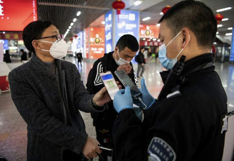 Tracking apps allow authorities to look back at someone's travel history in the previous 14 days and see if they visited areas considered high risk for COVID-19 (AFP Photo/NOEL CELIS)