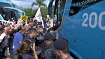 Brazilian team swarmed by anti-World Cup demonstrators