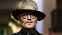 """Finding a purpose: Johnny Depp plays a troubled genius in """"Minamata"""""""