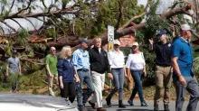 Trump surveys Michael's wrath, rescuers search for bodies