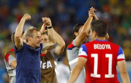 U.S. coach Juergen Klinsmann celebrates their win against Ghana after their 2014 World Cup Group G soccer match at the Dunas arena in Natal
