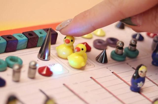 Here's a synthesizer made with beans, dolls and ducks