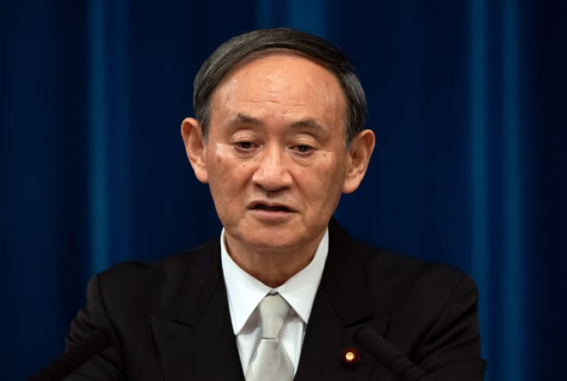 Yoshihide Suga speaks during a news conference following his confirmation as Prime Minister of Japan in Tokyo