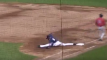 Minor leaguer does the splits on first base to complete a double play