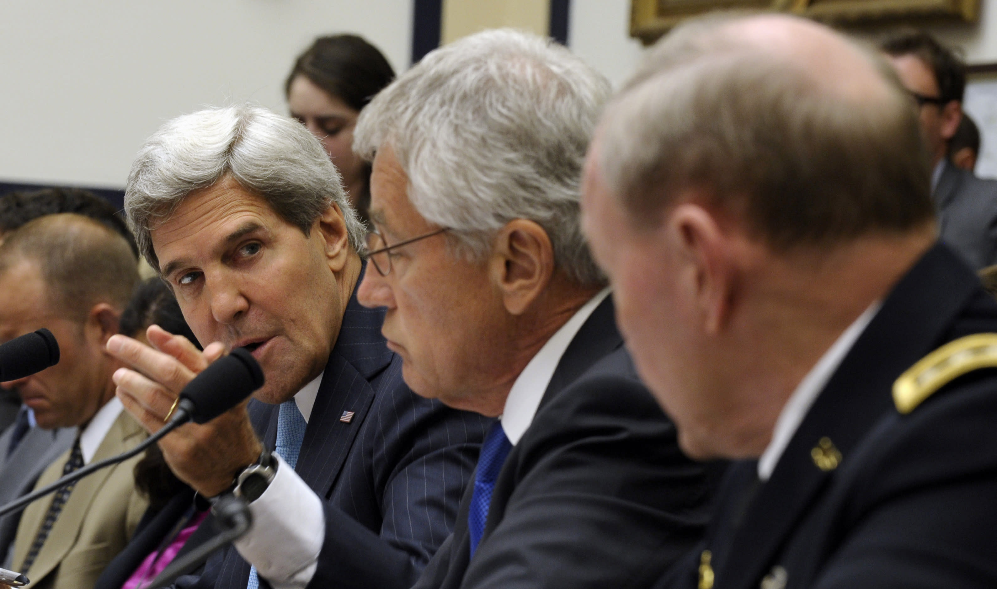 From left, Secretary of State John Kerry, Defense Secretary Chuck Hagel and Joint Chiefs Chairman Gen. Martin Dempsey, testify on Capitol Hill in Washington, Tuesday, Sept. 10, 2013, before the House Armed Services Committee hearing on Syria. (AP Photo/Susan Walsh)