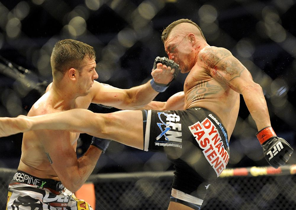 Myles Jury lands a punch on Diego Sanchez during a UFC 171 mixed martial arts lightweight bout, Saturday, March. 15, 2014, in Dallas. Jury won by decision