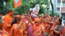 'The lion returns' -- Modi fans paint the town saffron