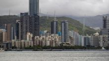 Families fear for Hong Kong fugitives in China custody