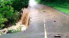 Flash flooding closes roads and bridges as forecasters warn of 40mm of rain in two hours