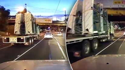 Car crushed after truck loses its load in collision