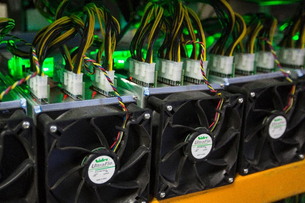 Bitcoin is mined at Bitfarms in Saint Hyacinthe, Quebec on March 19, 2018, a process which requires powerful computers that are voracious users of electricity