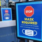 Which stores still require vaccinated people to wear masks after new CDC guidance?