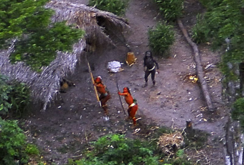 Members of an uncontacted tribe in Brazil's Amazon Basin were photographed by air in 2008. At least 10 members of a tribe in this region were allegedly killed by gold miners last month. (Ho New / Reuters)